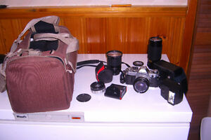 Canon AE1 camera, lenses, flash and equipment bag