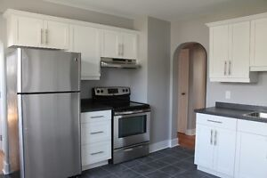 3 bd flat-renovated,washer/dryer,hdwd/tile flrs,heat incl.