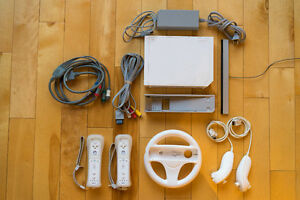 Wii Console + 2 Controllers + 2 Nunchucks + Wheel and more.