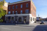 9 logements + 2 locaux commerciaux sur King Ouest
