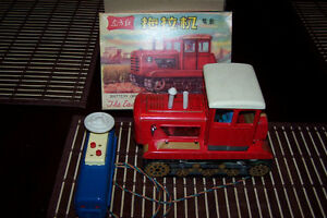 vintage tin tractor battery operated china the east is red.