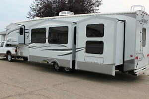 2013 SILVERBACK 35QBH4 FIFTH WHEEL.MUST SEE USED ONE TIME