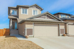Walkout basement backing onto pond!! Coaldale-quick to hwy!