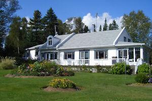 maison a vendre au bord de l' eau