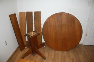 Round oak pedestle table