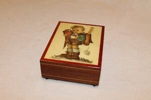 Italian made music box with Hummel picture.