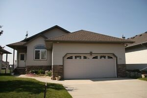 REDUCED***Executive Walkout Bungalow Backing onto Greenspace