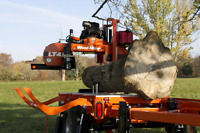 Portable sawmill wood-mizer for hire by the hour