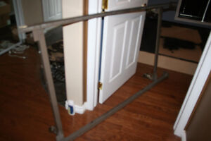 Free adjustable bed frame, water jug and sports picture frame.