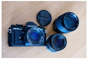 3 Zeiss Contax lenses and Yashica film camera