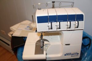 SEWING SERGER MACHINE ( used very little )