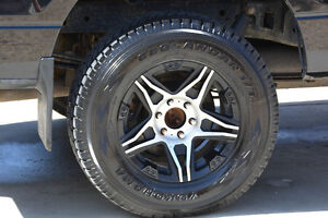 4 like new winters on aluminium rims, Ford 150