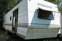 2004 Wildwood 38 Foot triple slide Travel trailer
