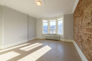 Exposed Brick, Tile Ceiling, Bay Window and Private Patio!!!