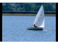 Laser sailing dingy boat with road trailer and launching trolley