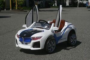 Ride-on electric toy car / Voiture électrique pour les enfants! West Island Greater Montréal image 3