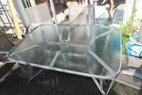 Sturdy Glass Table and 4 Matching Patio Chairs