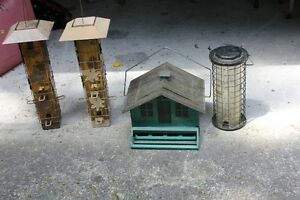 4 Bird feeders  used 1 has copper roof squirrel proof..