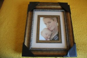 Two 11 x 14 picture frames. Studio Decor $30 for both