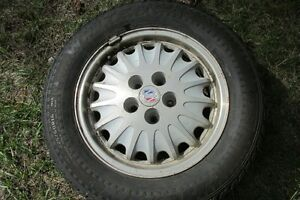 Four  studded  tires and wheels