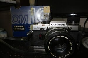old Olympus OM10 camera with flash and manuals