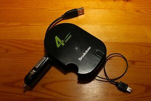 (BRAND NEW)Brookstone 4-way power adaptor for mobile electronics