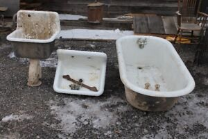Antique cast iron claw foot tub and sinks