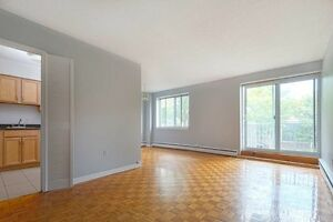 LARGE TWO BR CLOSE TO DAL & SMU WITH BALCONY AND 1.5 BATHROOMS