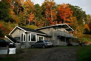 Cottage house with garage on 3 acres in Algonquin highlands.