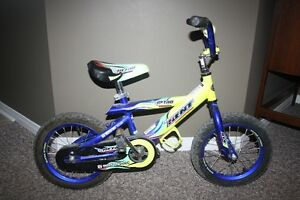 Selling a bike with 12 inch wheels and a blue helmet