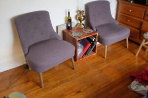 Pair of grey tufted occasional chairs.