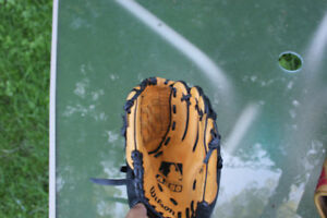 2 used baseball gloves