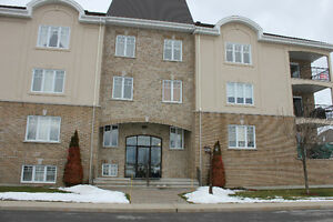 CONDO A MASCOUCHE PRES DU TRAIN