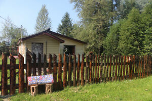 Cozy cabin ready to move in on half acre freehold title land