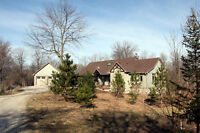 PRICE REDUCED! Beautiful home on 19 riverfront acres