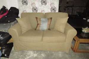 Beige Love Seat With Pillows