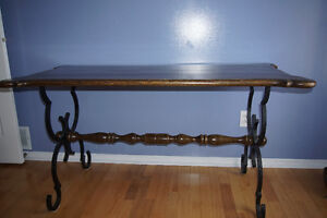 Wrought iron and wood table.