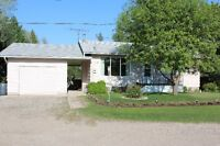 Country Retreat, large park like garden, nice house in Sask.