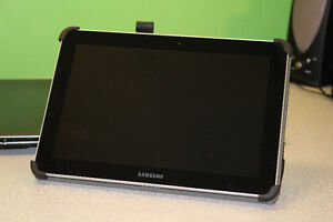 Samsung Galaxy Tab 10.1 c/w adapter & stand-up case.