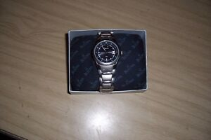 MENS BULOVA SOLAR TITANIUM WATCH