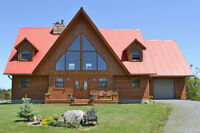 SUPERBE LOG HOME MLS# 15605955