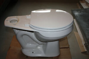 Two (2) almost new, Mansfield standard height, round toilet bowl