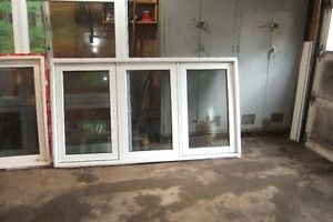 Solid vinyl windows with screens - various sizes