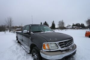 2002 Ford F-150 8Ft Box with a 4.6L V8 SOHC 16V