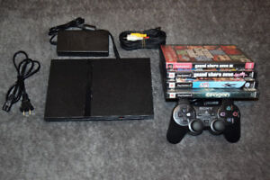 PS2 Slim console, controller, cables and 4 games $80