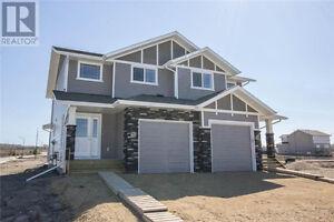 Brand New Two-Storey Duplex In Timber Ridge! NO CONDO FEES!
