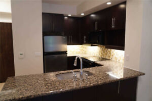 1 Bed + Den Ground Level Suite W/ Private Terrace