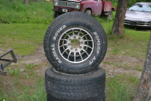 33 x12.5 x16.5 tires and silver  turbine rims