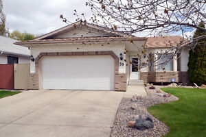 METICULOUSLY MAINTAINED 4 LEVEL SPLIT IN CLOVER BAR RANCH