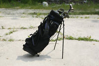 Complete used set of golf clubs and bag